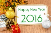 2016 on brown tag paper new year decoration